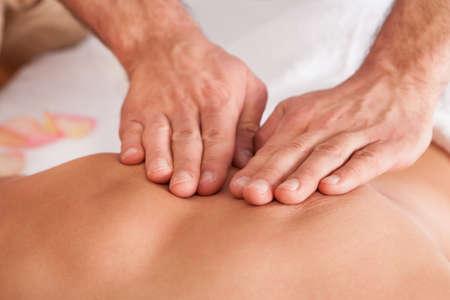 back massage: Beautiful young woman getting back massage at spa Stock Photo