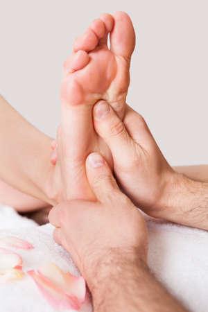 Beautiful young woman getting feet massage treatment at spa Stock Photo - 14017097