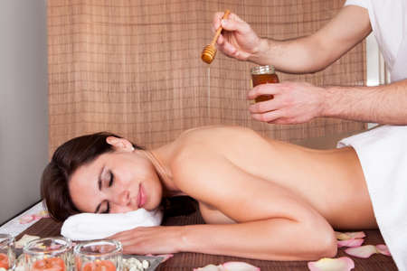 Beautiful young woman receiving spa treatment with honey Stock Photo - 14011771