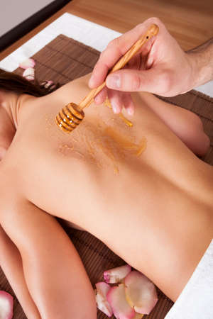 Beautiful young woman receiving spa treatment with honey Stock Photo - 14017830