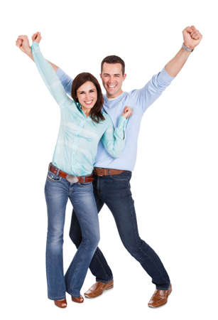 donna entusiasta: Ritratto di bella giovane coppia. Isolato su sfondo bianco Archivio Fotografico