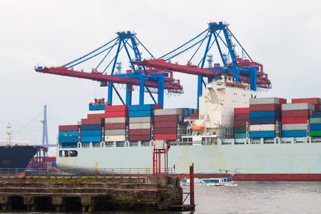 shipping port: Huge container ship fully loaded in port terminal