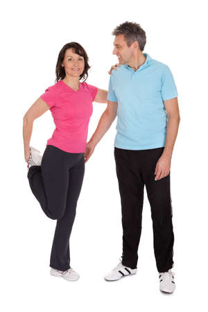 Active mature couple doing fitness  Isolated on white Stock Photo