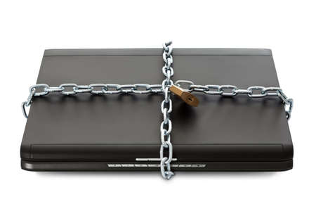 Laptop with chains and lock. Security concept. Isolated on white photo