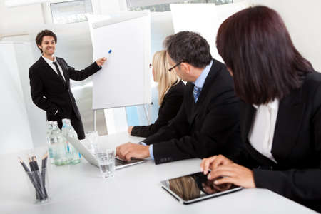 visual aid: Group of business people at presentation in the office Stock Photo