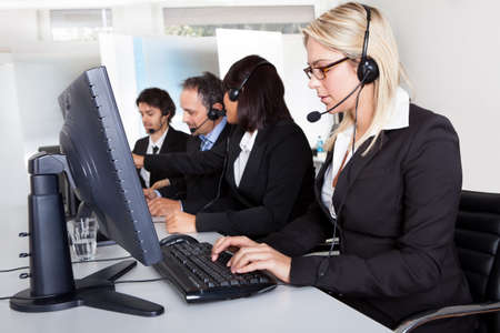 personal call: Group of young business customer service people Stock Photo