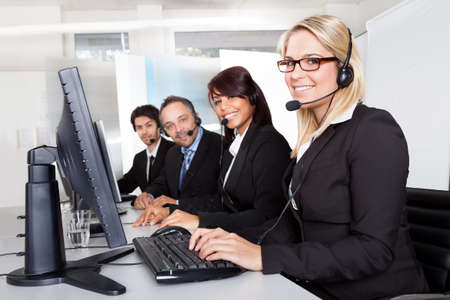 customer care: Group of young business customer service people Stock Photo