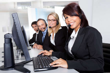 business centre: Group of young business customer service people Stock Photo