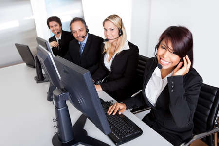 customer assistant: Group of young business customer service people Stock Photo