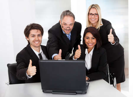 Group of business people at the meeting discussing Stock Photo - 14314044