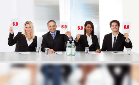 committee: Group of panel judges holding perfect score signs Stock Photo