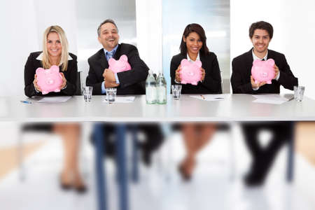 Group of business people holding piggy banks photo