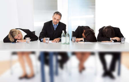 tired businessman: Group of business people sleeping at the meeting Stock Photo