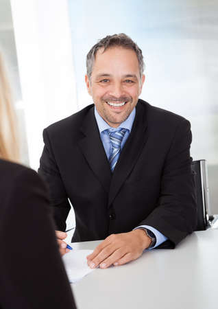 Portrait of successful businessman at the interview photo
