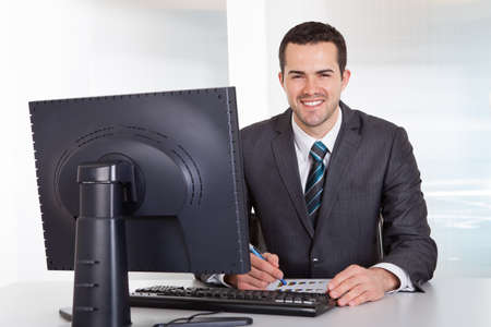 Successful businessman working at desk at the office Stock Photo - 14929769