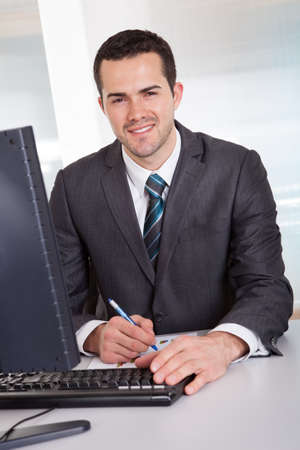Successful businessman working at desk at the office Stock Photo - 14929789