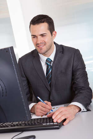 Successful businessman working at desk at the office Stock Photo - 14929507