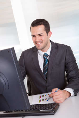 Successful businessman working at desk at the office Stock Photo - 14929721