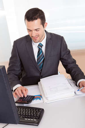 Successful accountant working with financial data in the office Stock Photo - 14929470