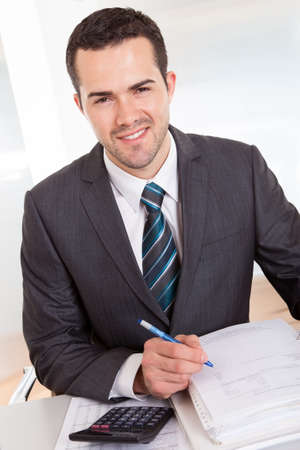 Successful accountant working with financial data in the office photo