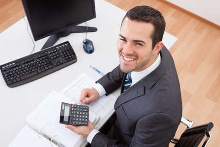 young executives: Successful accountant working with financial data in the office Stock Photo