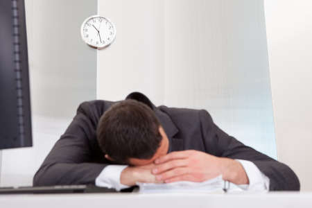 bore: Successful businessman sleeping at desk it the office Stock Photo