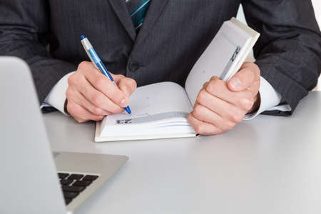 Successful businessman working at desk at the office photo