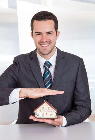 Successful businessman presenting model of the house Stock Photo - 14929173