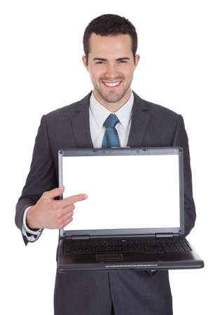 Portrait of successful businessman with laptop. Isolated on white Stock Photo - 14932011