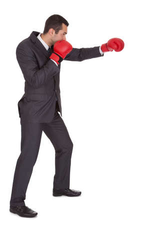 Competitive businessman in boxing gloves. Isolated on white Stock Photo - 15000893
