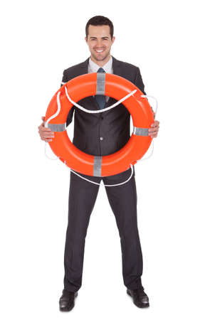 life buoy: Young businessman with life buoy. Isolated on white Stock Photo