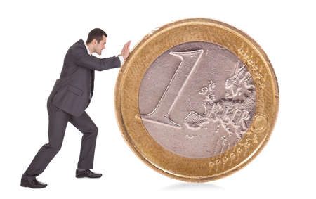 Successful businessman pushing one euro coin. Isolated on white photo