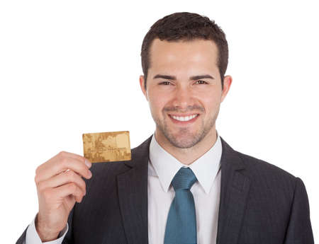business card in hand: Successful businessman holding credit card. Isolated on white Stock Photo