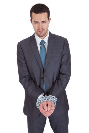 Businessman hands bound in chains. Isolated on white Stock Photo - 14930104