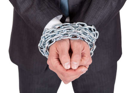 hard bound: Businessman hands bound in chains. Isolated on white