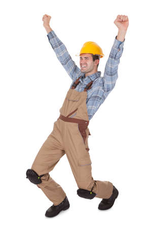 tradesmen: Excited worker wearing hard hat. Isolated on white