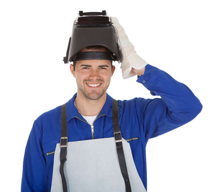 Portrait of confident young welder. Isolated on white photo
