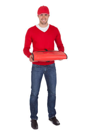 pizza delivery: Portrait of pizza delivery boy with thermal bag. Isolated on white