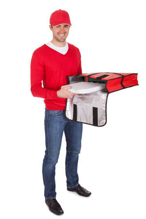 delivery boy: Portrait of pizza delivery boy with thermal bag. Isolated on white