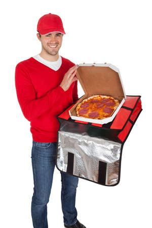 Portrait of pizza delivery boy with thermal bag. Isolated on white
