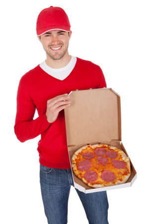Portrait of pizza delivery boy with thermal bag. Isolated on white photo