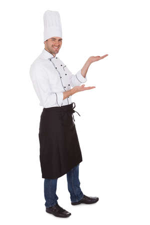 professional chef: Portrait of happy chef. Isolated on white Stock Photo