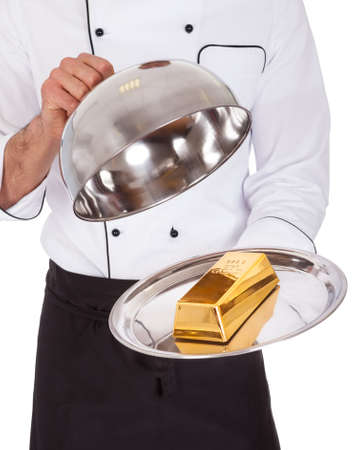 Portrait of happy chef holding tray. Isolated on white photo