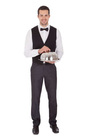 waiter tray: Portrait of a cheerful young butler. Isolated on white Stock Photo