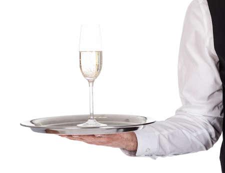 sektglas: Portrait eines jungen Butler mit Champagner-Glas. Isoliert auf weißem