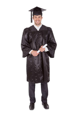 graduate students: Cheerful young graduation man. Isolated on white Stock Photo