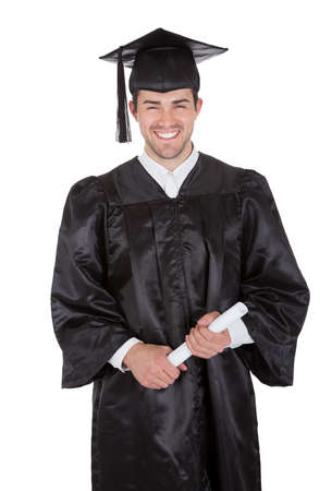 cap and gown: Cheerful young graduation man. Isolated on white Stock Photo