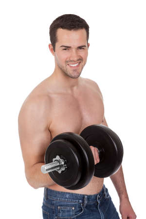 powerful man: Young man exercising his biceps. Isolated on white Stock Photo