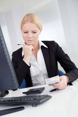 Cheerful accountant businesswoman working in the office Stock Photo - 15211842