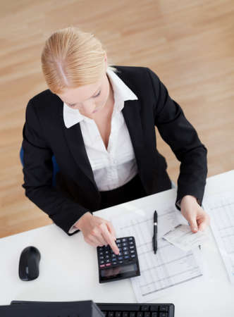 topdown: Cheerful accountant businesswoman working in the office